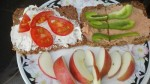 1 tomatoe, 1 bell pepper, small loaf of pumpernickel broad, tub of Fresh Cheese with herbs, and an apple-2 people, 2 light meals--total cost for all--$3.50